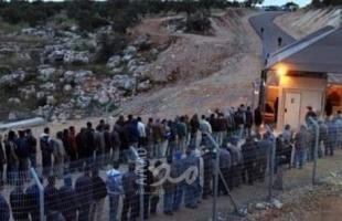 بدء دخول آلاف العمال الفلسطينيين إلى إسرائيل- صور